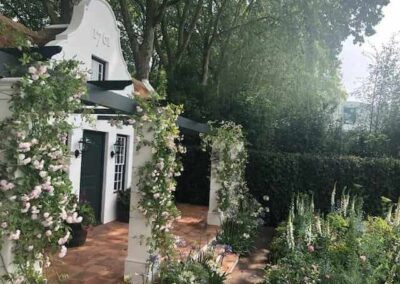 Gardengigs-1761-COTTAGE-Chelsea-Flower-Show-House-with-Vine-Flowers