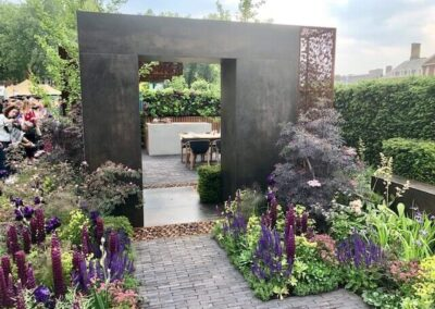 Gardengigs-URBAN-FLOW-Chelsea-Flower-Show-Garden-With-Violet-Flowers