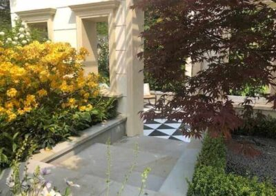 Gardengigs-VARIOUS-GARDENS-Chelsea-Flower-Show-Red-Tree-Yellow-Flowers